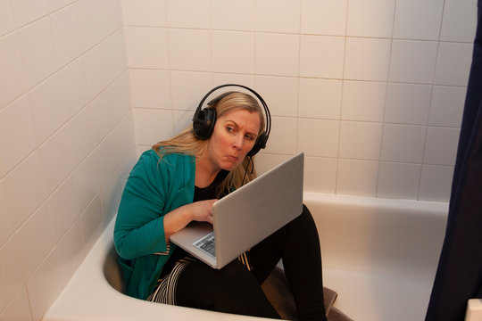 hiding in the tub working from home