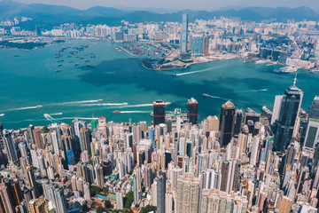 Fotomurales - Aerial scenery panoramic view from drone of Hong Kong skyscrapers skyline with metropolitan bay. Modern concrete cityscape of urban downtown with business and financial buildings. City infrastructure