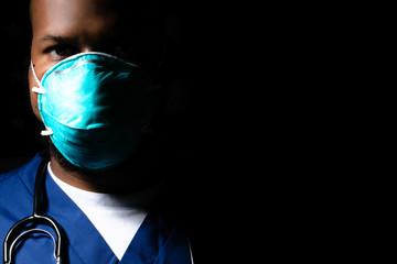 Moody portrait of medical healthcare worker wearing n95 mask