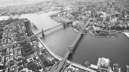 Wall Mural - New York City aerial view from helicopter in slow motion. Brooklyn and Manhattan Bridges in black and white