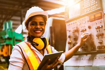 Portrait of industrial worker standing with tablet holding in her hand feeling proud and confident looking for the new opportunity, Concept business continuity, Industry business continuity planning.