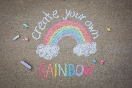 Create your own rainbow words with rainbow drawn with sidewalk chalk on the ground - temporary art