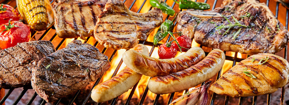 Large assortment of meat grilling on a barbecue
