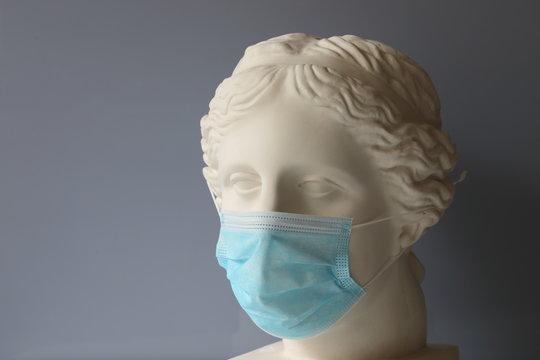Gypsum head of Venus with a mask put on, illustrating strict quarantine measures