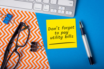 Do not forget pay utilities services bills. Message on worplace about the need to pay utility bill Wall mural
