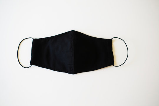 Black reusable cloth face mask  isolated on white background.