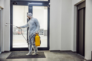 Sanitizing interior surfaces. Cleaning and Disinfection inside buildings, the coronavirus epidemic. Professional teams for disinfection efforts. Infection prevention and control of epidemic.