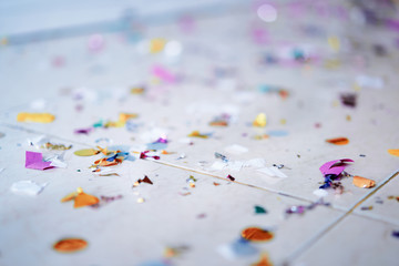 Fotobehang Macrofotografie After party. Colorful confetti on the floor.