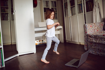 child dancing,aerobics in online video chat laptop