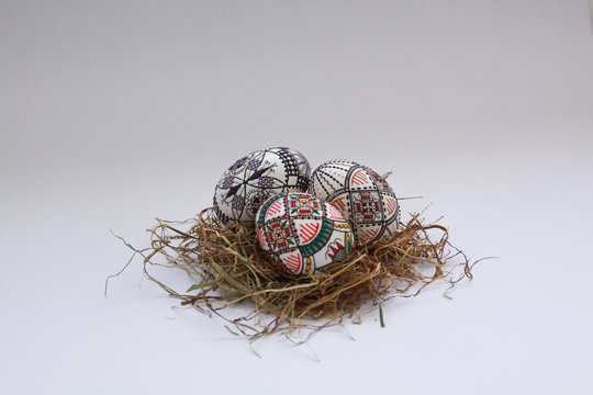 Traditional painted handmade Easter eggs on hay