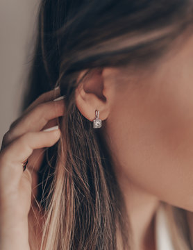 Beautiful elegant silver earring with diamond on close-up
