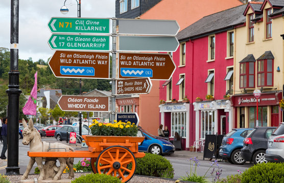 Bantry, Ireland - 25th July 2018: Direction signs in town of Bantry for tourist places of interest on the south west coast of Ireland
