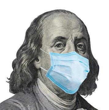 Benjamin Ben Franklin face banknote with a face mask against infection on US 100 dollar isolated.