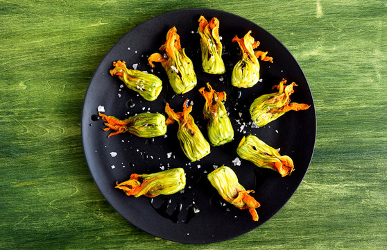 Overhead view of squash blossoms with burrata and tapenade