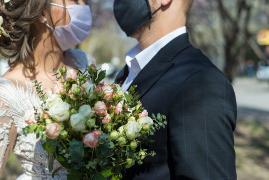 coronavirus infection 2020. Kovid 19. Portrait of a masked bride and groom during a wedding ceremony. Oudoor. Weddings during the period of quarantine and pandemic of coronavirus infection