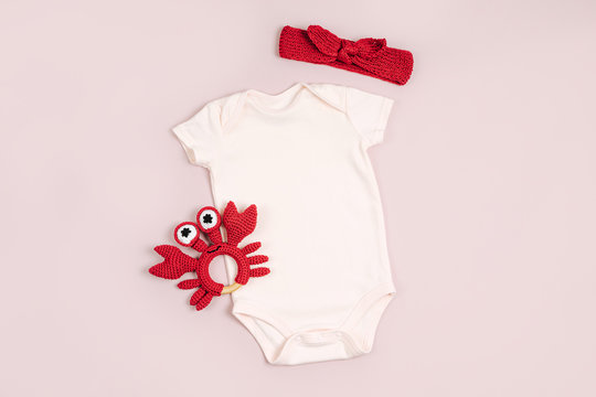 Cute baby bodysuit with toys. Set of kids clothes and accessories. Fashion newborn. Flat lay, top view