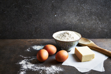 Baking ingredients on rustic stone background. Still life. Copy space