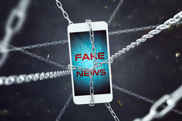 Smartphone with fake news inscription in chains. Conception of increasing problem of fake news.