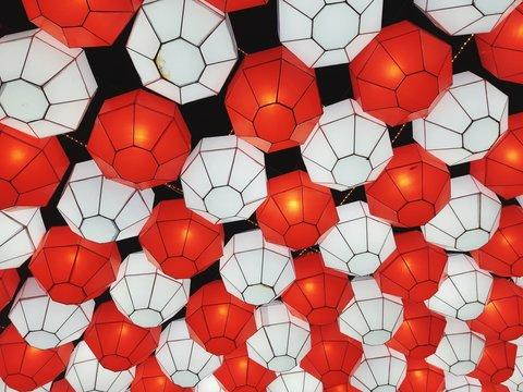 Full Frame Shot Of Illuminated Lanterns Hanging Outdoors At Night