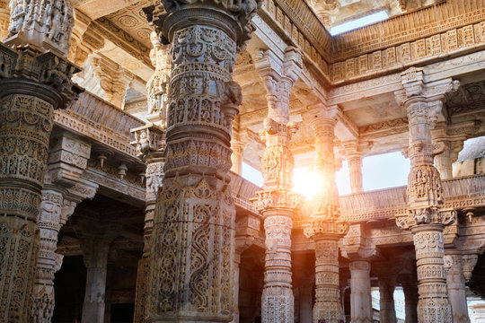 Columns pillars of beautiful Ranakpur Jain temple or Chaturmukha Dharana Vihara. Marble ancient medieval carved sculpture carvings of sacred place of jainism worship. Ranakpur, Rajasthan. India