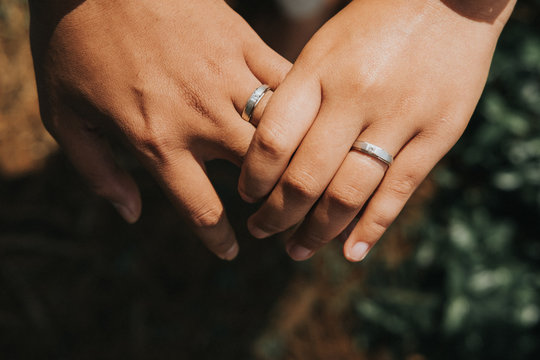 Cropped Image Of Lesbian Couple Wearing Rings