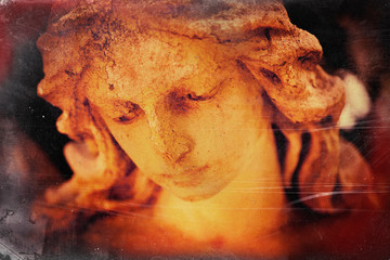 Fotomurales - Vintage and retro styled image of ancient stone statue of beautiful sad angel as symbol of death and unspeakable sadness.
