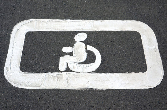 Parking markings for disabled people in a parking lot for cars.
