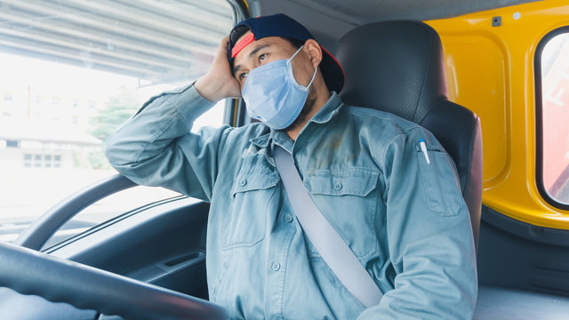 Truck drivers wear a medical facemask for protection. During the coronavirus outbreak