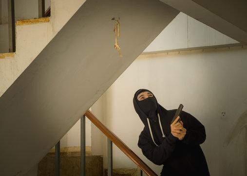 Criminal Holding Gun In Building
