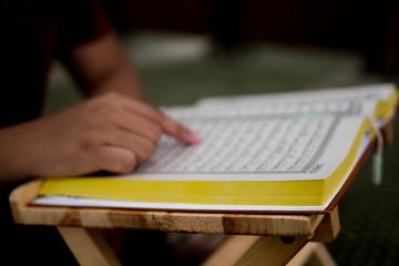 Close-up Of Person Reading Koran