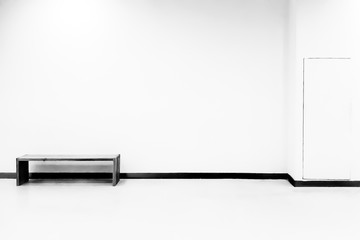 Bench On Floor Against White Wall