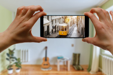 Travel at home. Online trip to Lisboa, Portugal by smartphone. Fotobehang