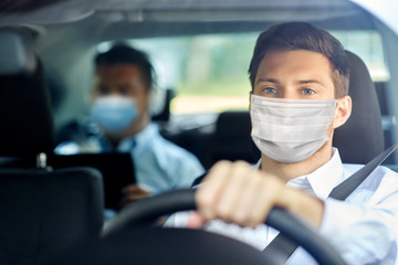health protection, safety and pandemic concept - male taxi driver wearing face protective medical...