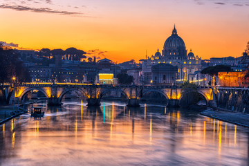 The St. Peters Basilica in the Vatican City and the Tiber after sunset Fotomurales