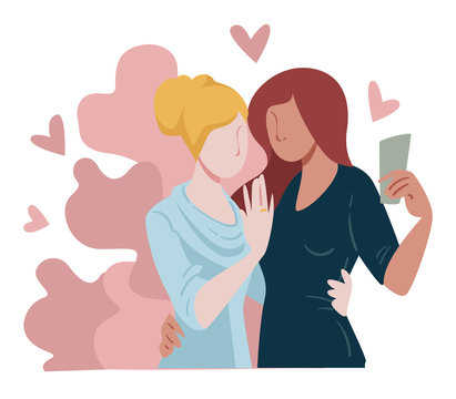 Engaged lesbian couple taking selfie of precious moment