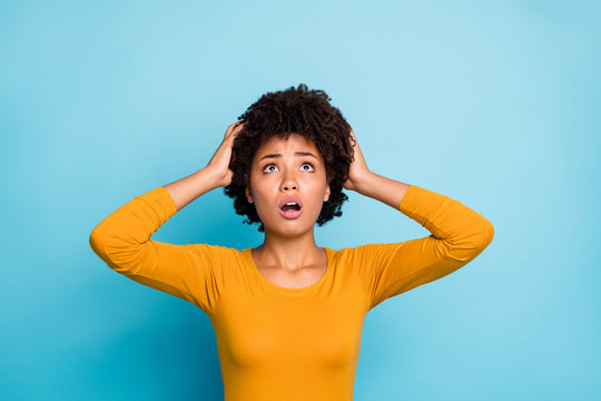 My god what should i do. Frustrated anxious afro american have many problems get fired job touch hands head look copyspace up wear stylish trendy pullover isolated blue color background