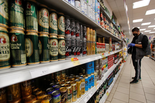 Cans and bottles of beer are displayed for sale in a supermarket in Moscow