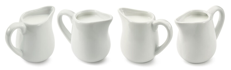 Set of ceramic milk jars or creamers isolated on white background. Package design element with clipping path Wall mural