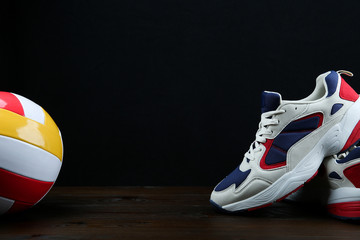 dark background with sneakers and volleyball  ball with copy space Wall mural