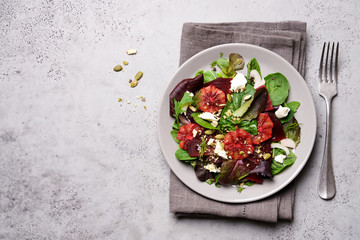 Beetroot salad with orange, cheese and mix of nuts, pumpkin seeds. Bright salad for cleen eating, detox