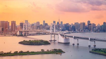 Fototapete - Tokyo. Cityscape image of Tokyo, Japan with Rainbow Bridge during sunset.