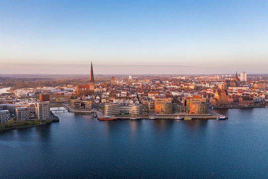 panorama of the city of rostock - aerial view over the river warnow, skyline during sunrise