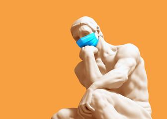 Thinker In Medical Mask. Concept Of Coronavirus Quarantine.