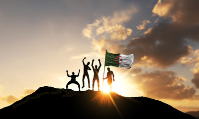 A group of people celebrate on a mountain top with Algeria flag. 3D Render