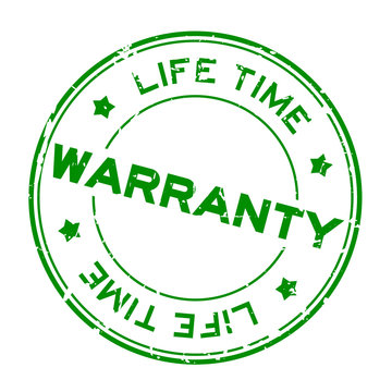 Grunge green warranty life time round rubber seal stamp on white background