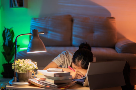Asian women tired from working at home She felt sleepy