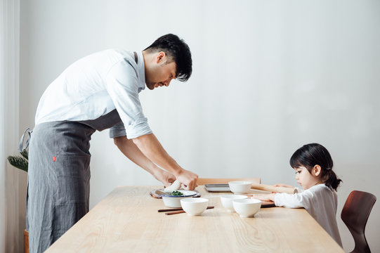 Father and daughter at home dumplings
