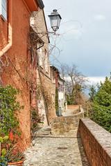 Wall Mural - Old street in italian small town