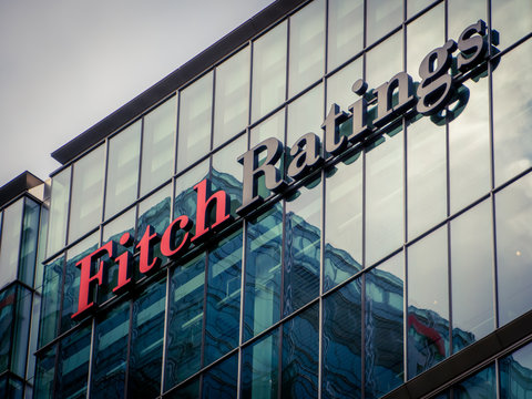 LONDON- Fitch Ratings building Canary Wharf, exterior logo of one of the 'big three' credit ratings agencies.