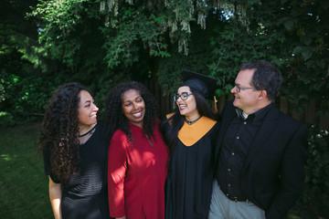 Family of four celebrating a high school graduation